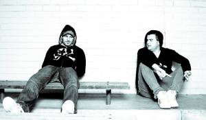 Dean Paps & Adam Bartas of Orkestrated sitting in a train station