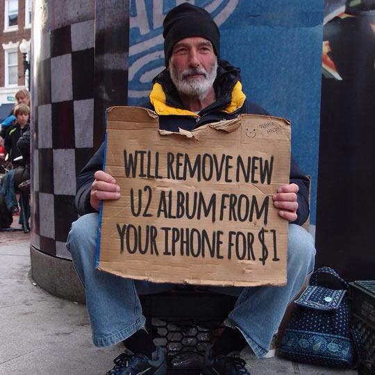 Meme regarding the U2 album can be deleted for $1 from a random on the street