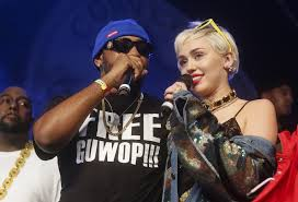 Miley Cyrus, right, joins Mike Will Made It onstage at the Fader Fort Presented by Converse
