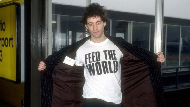Bob Geldof in 1985 wearing Feed the World t-shirt