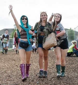festival goers and hunter wellingtons