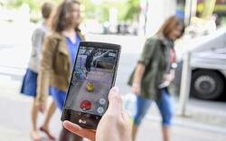 Person-playing-Pokemon-Go-on-their-smartphone-xlarge